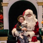 This little boy and his puppy were so cute with Santa!