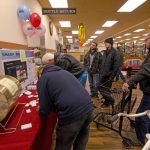 Visitors signed up for great prizes like a gas grill, a tv, bike and more!