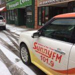 Sunny FM Car Outside Business