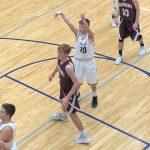 Jackson Sager shooting a basket. Negaunee Miners VS Menominee Maroons.