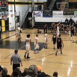 Negaunee Miners Boys basketball VS Gwinn ModelTowners action shot.