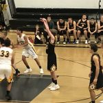 Gwinn ModelTowner at the free-throw line in the Miners Boys basketball VS ModelTowners game.