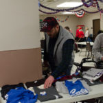 Bruce finding a t-shirt for one Veteran.