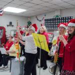 The group sang popular carols like Jingle Bells and Silent Night.