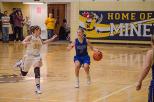 Playing defense while Ishpeming has control of the ball.