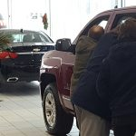 Happy customers at Frei Chevrolet with a Silverado