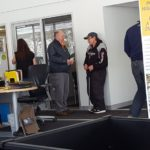 Jim Grundstrom talking with a satisfied customer at Frei Chevy.