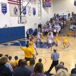 Negaunee_Miners_Boys_Basketball_VS_Ishpeming_Hematites_Jakson Sager has the ball for Negaunee
