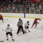 Kevin Rudden from the Negaunee City Fire Department picking up the puck.