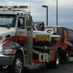 WRUP Van hooked up to the Crossroads Truck Repair wrecker.