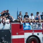 Ishpeming's Track and Field team road on one of the fire trucks.
