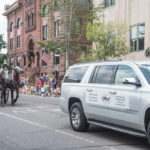 Canale Tonella Funeral Home with their beautiful dapple gray draft horses.