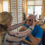 Grace checked the fitting of the new sunglasses noting that they needed a little adjusting.