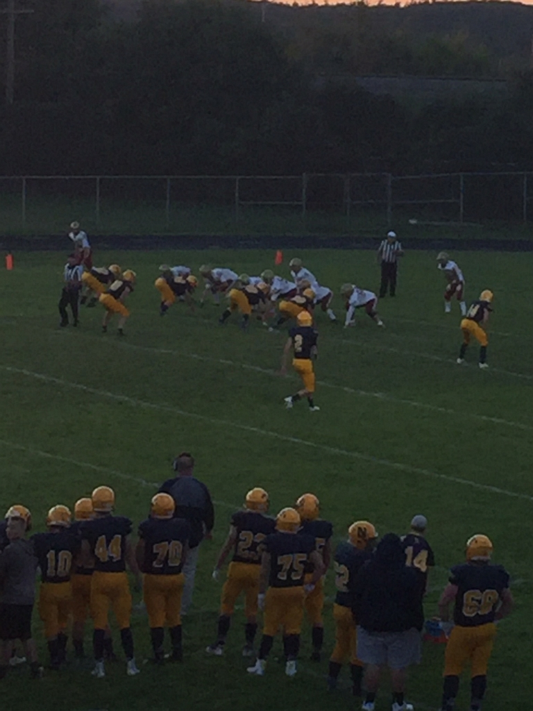 The Negaunee Miners and Manistique Emeralds take the field.