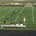 Warming up on the field in Manistique.