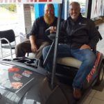 Luke Noordyk and Bill Tibor checking out the golf cart that you can win at Frei Chevy.
