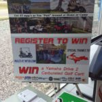 Read this sign and sign up to win the golf cart at Frei Chevy!