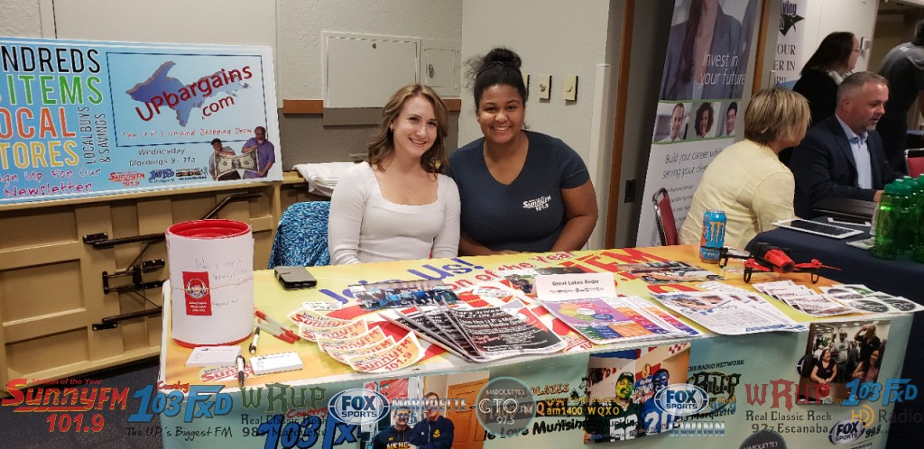 Sunny.FM's Kelsey Reyes and GLR's Lauren Bareiss at the NMU Fall Job Fair.