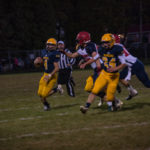 Negaunne Miners Quarter Back Jason Waterman making a play for first down.