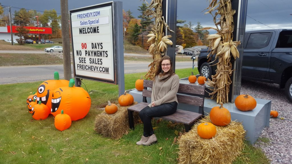 Frei Chevy saleswoman Lisa showing off the pumpkin display outside the showroom