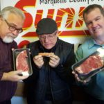 Major Discount inspecting his hot dog while Walt and Mark show off their beautiful New York Strips!