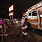 Santa wishing everyone a Merry Christmas.