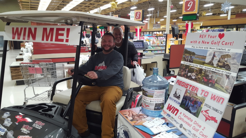 Zach and Bill at Econo Foods with the Golf Cart Grand Prize!