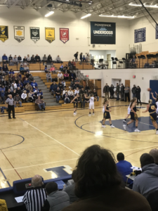 The Negaunee Miners on the offensive attack in the Ishpeming Hematites' gymnasium