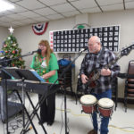 These two did a great job leading us in Christmas carols while the veterans checked out the items.
