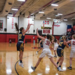 Miners #22 finds a break in the Marquette defense and takes her shot.