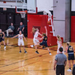 The Marquette Redettes blocked this attempt at a basket.