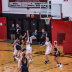 The Marquette defense was strong, but she managed to get the ball in the air and to the basket!
