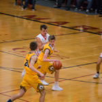 The Negaunee Miners gain possession of the ball.