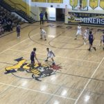 Purple Hornet takes ball down court
