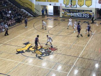 Purple Hornet takes ball down court