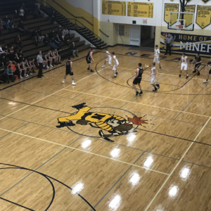 The action was intense in the Negaunee gymnasium as the Miners boys basketball team faced the Houghton Gremlins