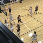 Both teams looking on at the shot, as the Negaunee Miners defeated the Westwood Patriots on Sunny 101.9FM.
