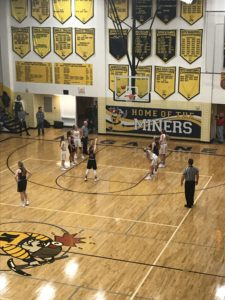 Westwood shots a free throw against the Negaunee Miners.