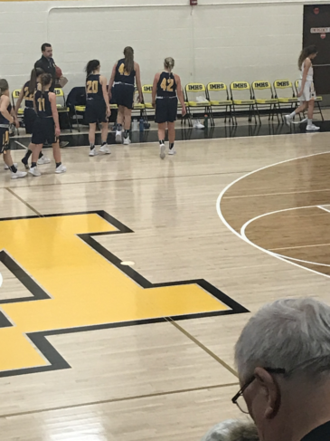 Negaunee goes back to their bench during their game against the Iron Mountain Mountaineers