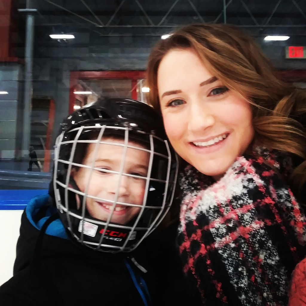 Kelsey and her son Holden at his school field trip to the ice arena for ice skating