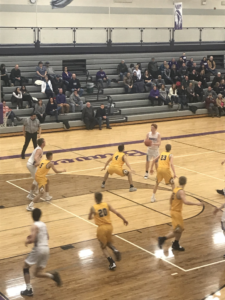 Gladstone controls the ball on the top of the key in their 49-33 loss against the Negaunee Miners on 101.9 SunnyFM.
