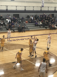 Negaunee contests a Gladstone shot in their 49-33 win on 101.9 SunnyFM.