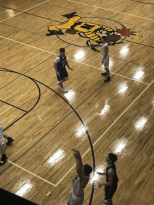 The Miners shoot a three-point shot in their 56-48 win over the Ishpeming Hematites on 101.9 SunnyFM