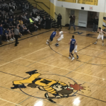 Ishpeming drives to the basket from the wing against Negaunee.