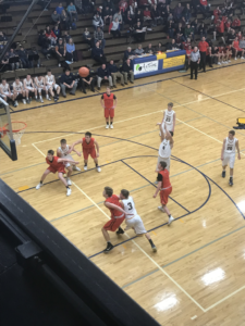 Negaunee shoots a free throw in their 67-36 loss against the Marquette Redmen on 101.9 SunnyFM.