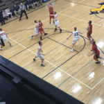 The Patriots shoot a three-pointer in their loss to the Negaunee Miners.