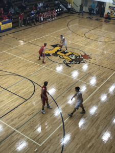 Negaunee dribbles the ball up court in their 56-47 defeat of the Westwood Patriots in the District 66 semi-finals on 101.9 SunnyFM.