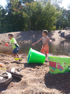 Kelsey's nephew, Titan, and son, Holden, playing at Lake Superior last summer