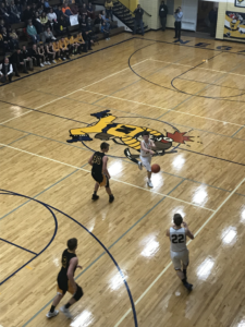 The Miners cross half-court with the ball during their 49-47 defeat of the Gwinn Modeltowners on 101.9 SunnyFM.