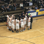 The Miners huddle up during a timeout.